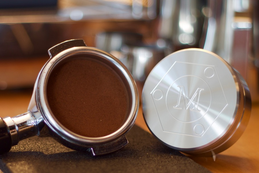 Fitted tampers compact all grounds into the coffee puck